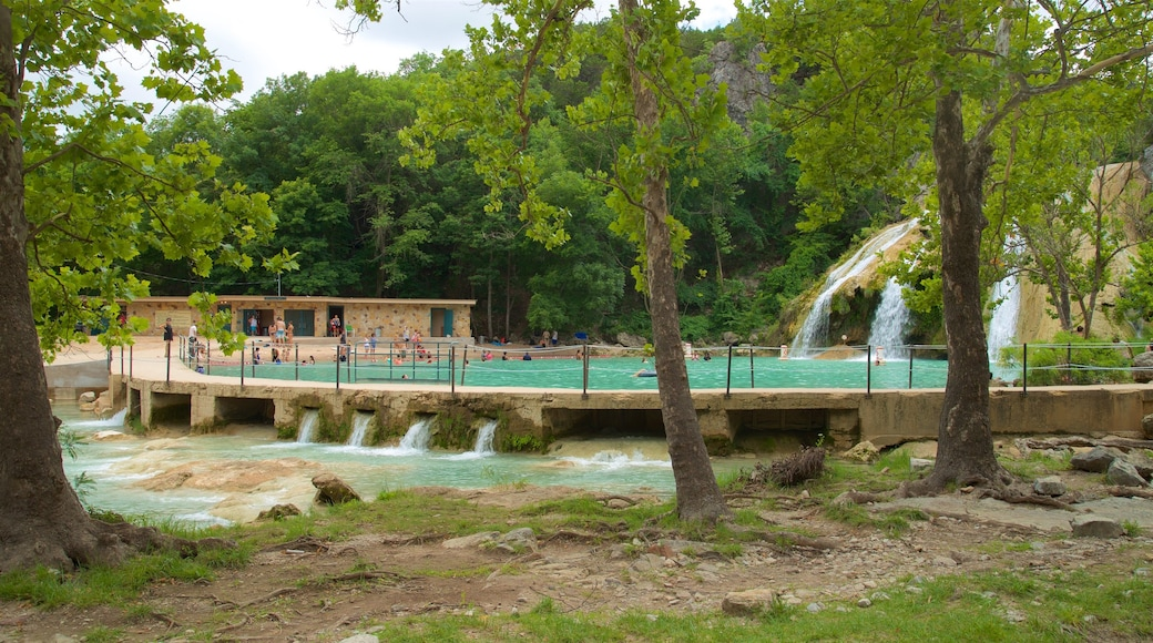 Turner Falls featuring a cascade and a lake or waterhole