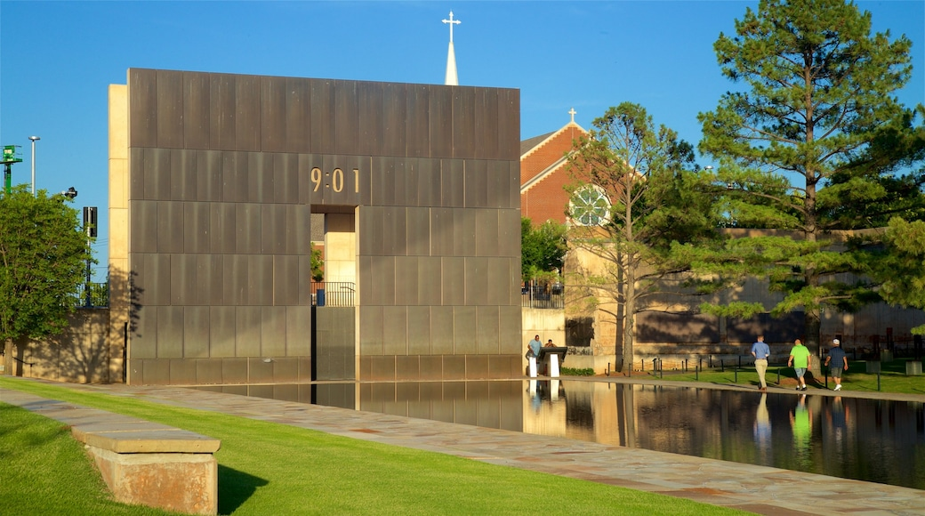 Oklahoma City National Memorial and Museum showing modern architecture, a garden and a pond