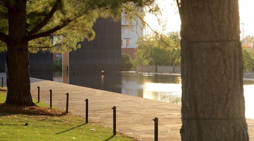 Oklahoma City National Memorial and Museum which includes a pond, a garden and a sunset