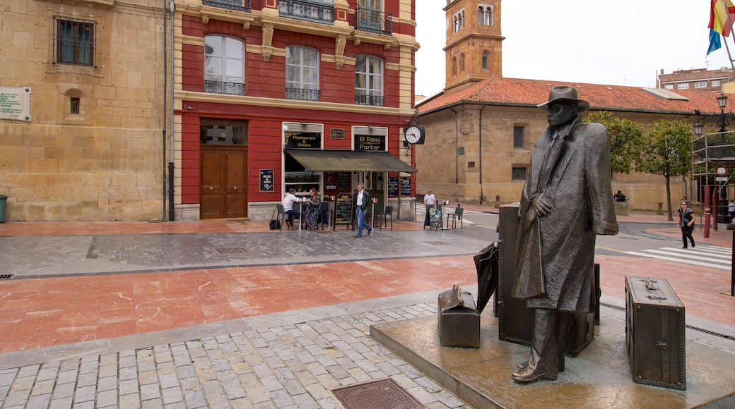 Plaza de Porlier featuring heritage elements and a statue or sculpture