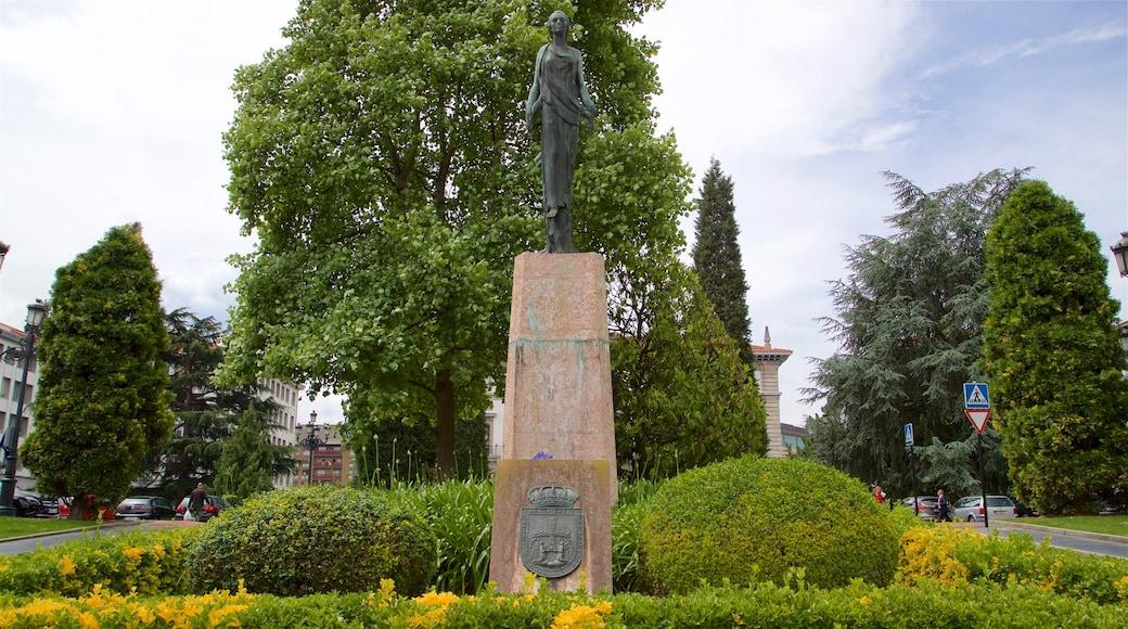Plaza de Espana which includes a statue or sculpture and a park
