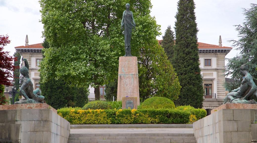 Plaza de Espana which includes a garden and a statue or sculpture