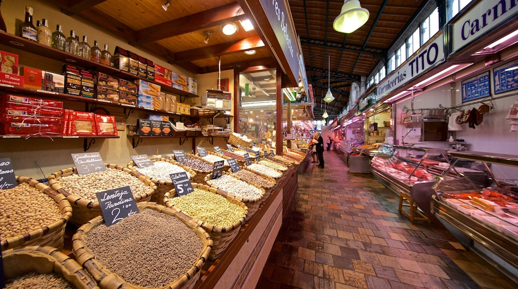 Mercado La Esperanza which includes food, markets and interior views