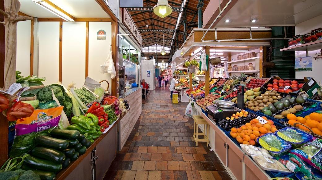Mercado La Esperanza which includes interior views, food and markets