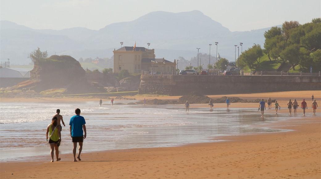 Playa del Camello mostrando vistas de una costa y una playa de arena y también una pareja