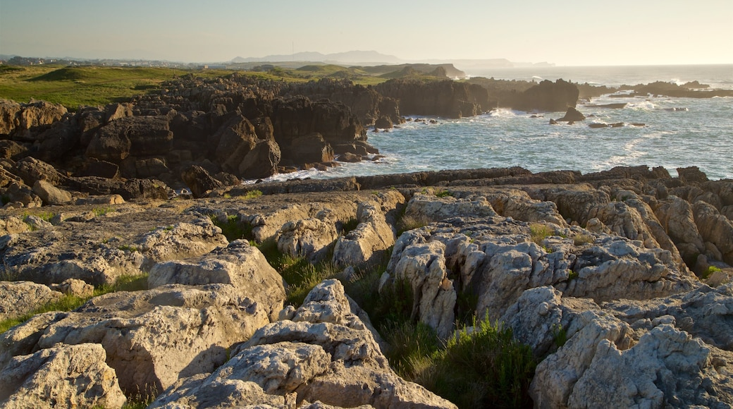 Santander - Cantabrian Coast which includes rocky coastline, a sunset and general coastal views