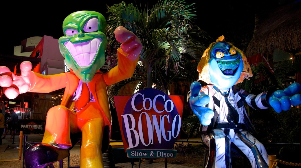 Cancun which includes night scenes, outdoor art and signage
