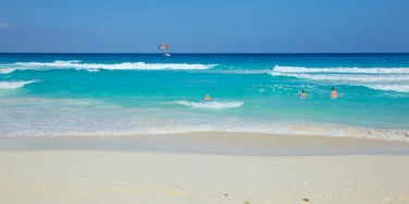 Cancun featuring general coastal views, swimming and a sandy beach