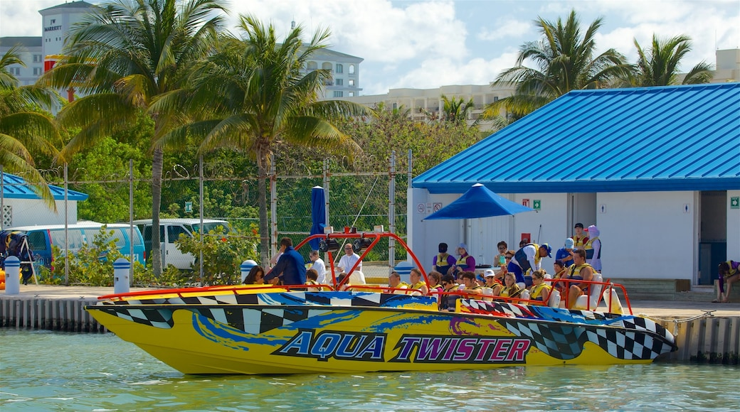 Aquaworld featuring signage and boating as well as a small group of people