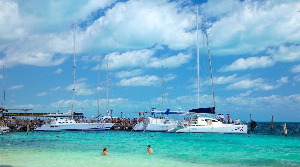 Playa Tortuga featuring a bay or harbor, swimming and general coastal views