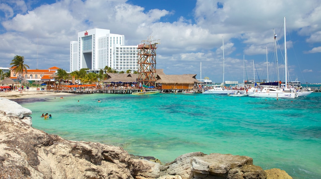 Playa Tortuga which includes swimming, general coastal views and a coastal town