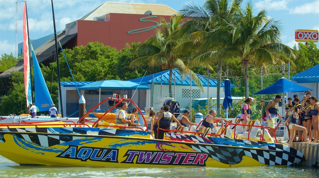 Aquaworld showing signage and boating as well as a small group of people