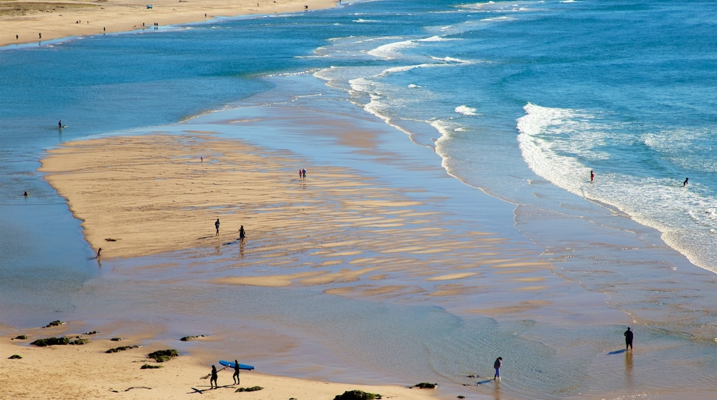 Coolangatta featuring a sandy beach and general coastal views as well as a small group of people