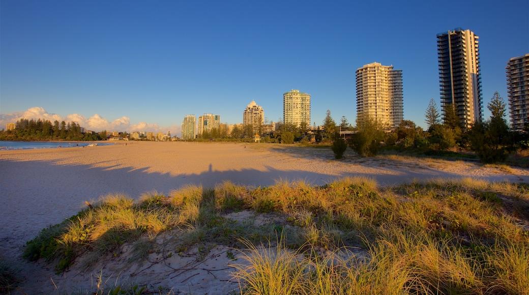 Coolangatta Beach featuring a sandy beach, a city and a coastal town