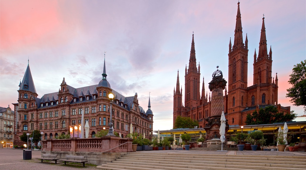 Marktbrunnen featuring heritage architecture, a sunset and a church or cathedral
