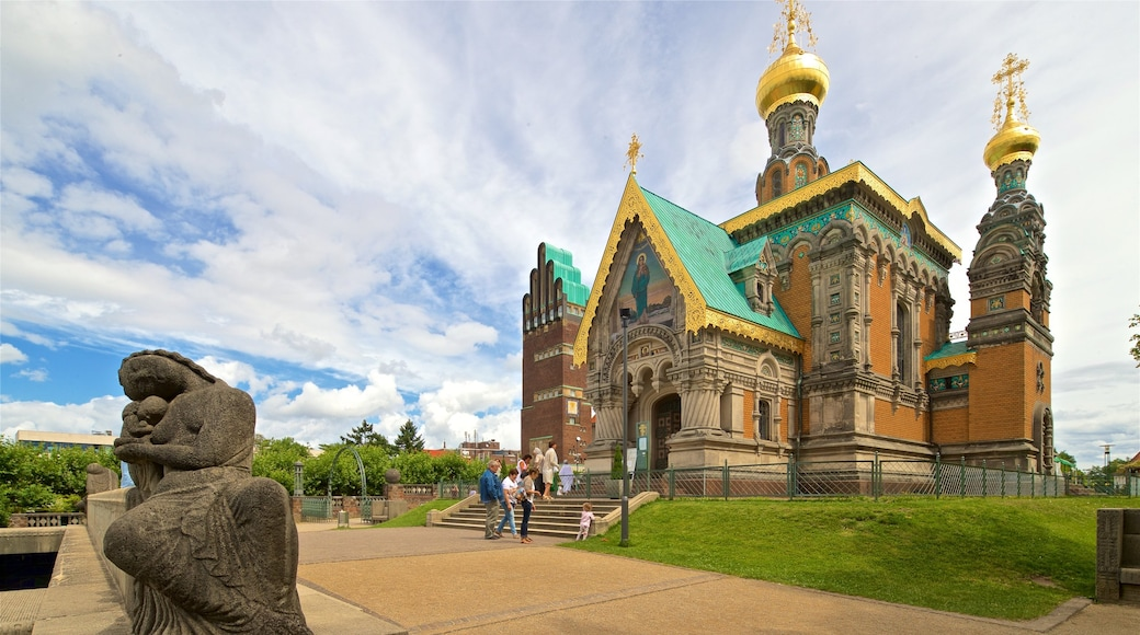 Russian Chapel featuring heritage architecture and a church or cathedral as well as a small group of people