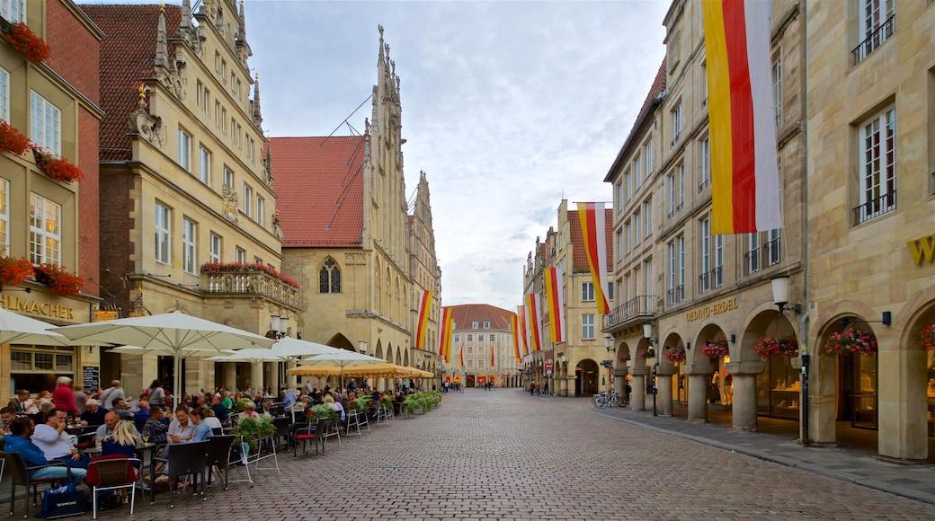 Münster welches beinhaltet Geschichtliches und Essen im Freien sowie kleine Menschengruppe
