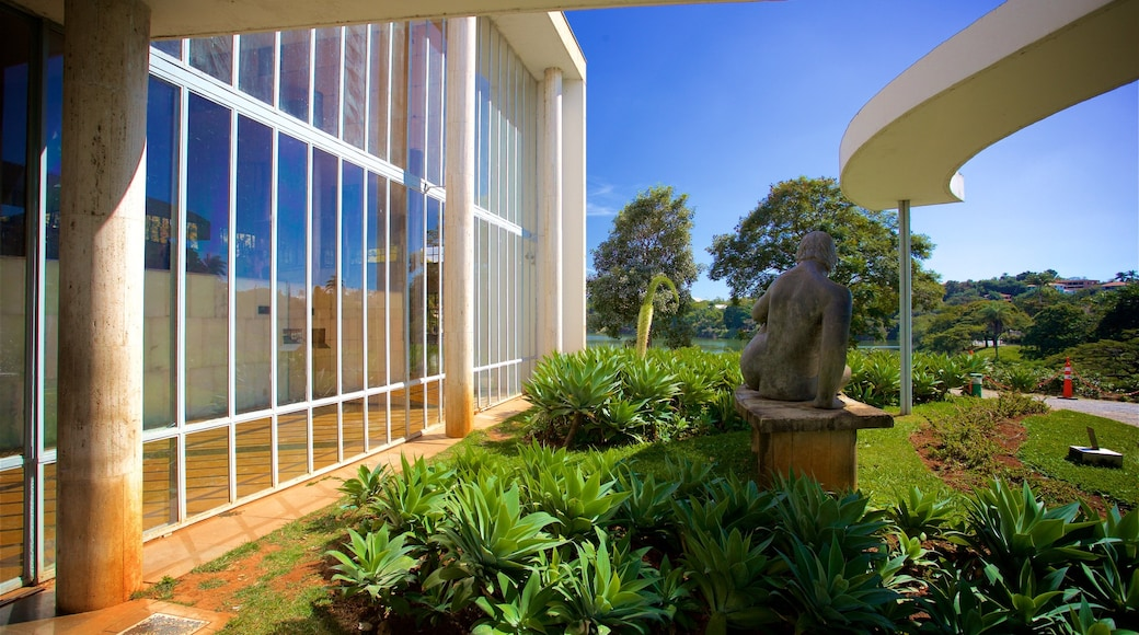 Pampulha Art Museum featuring a garden and a statue or sculpture