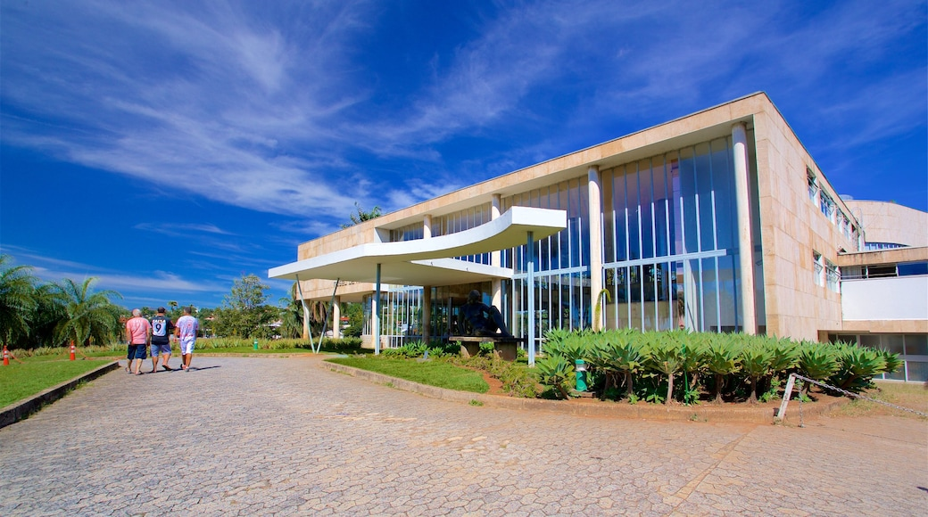 Pampulha Art Museum which includes a park and modern architecture as well as a small group of people