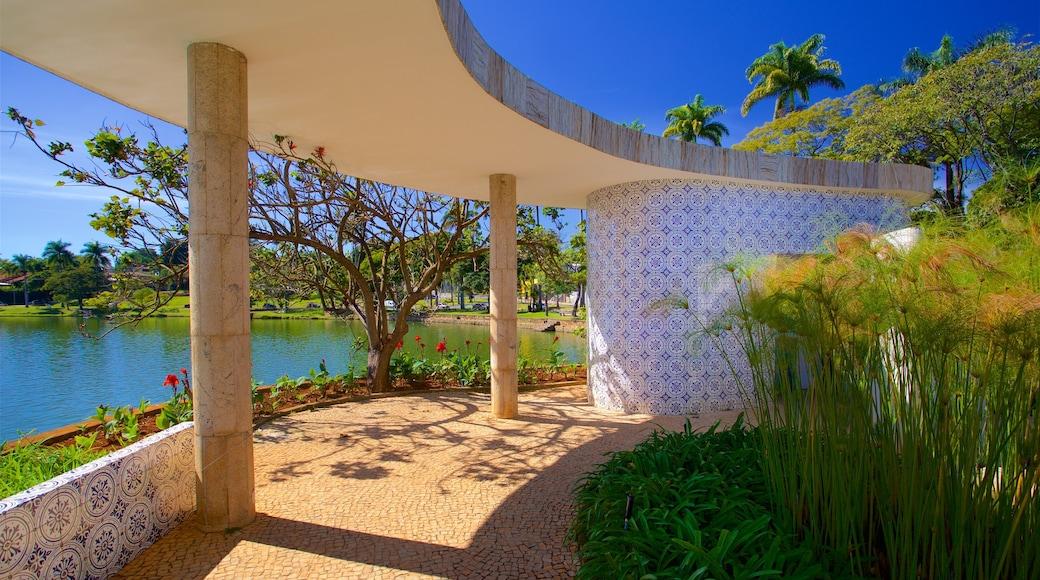 Casa do Baile featuring flowers, a lake or waterhole and a garden