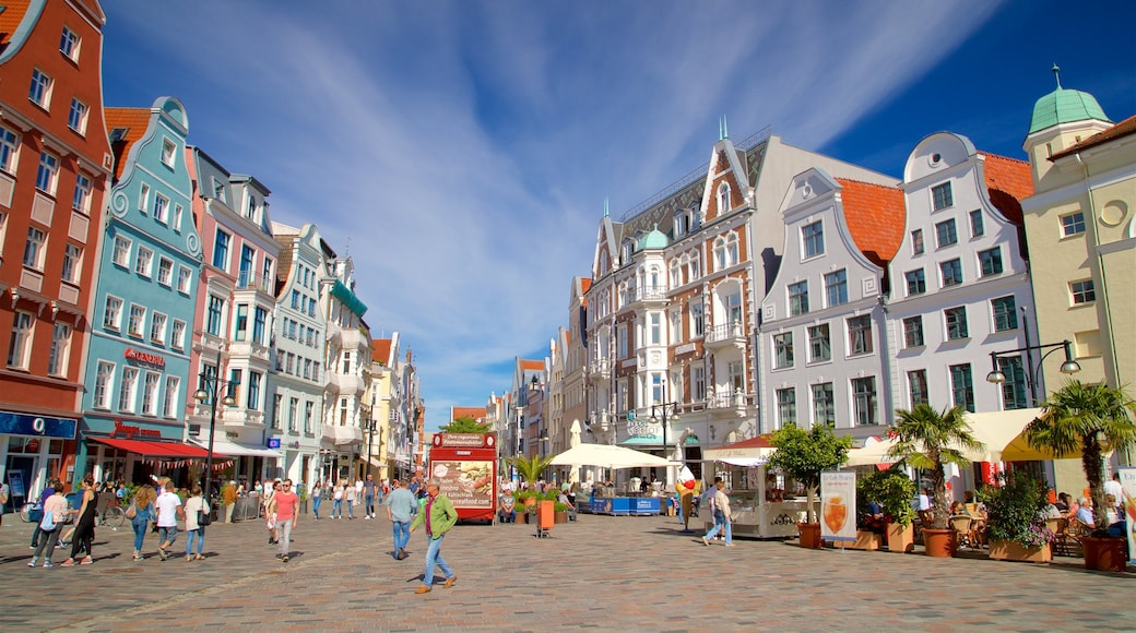 Rostock which includes street scenes and a square or plaza as well as a small group of people