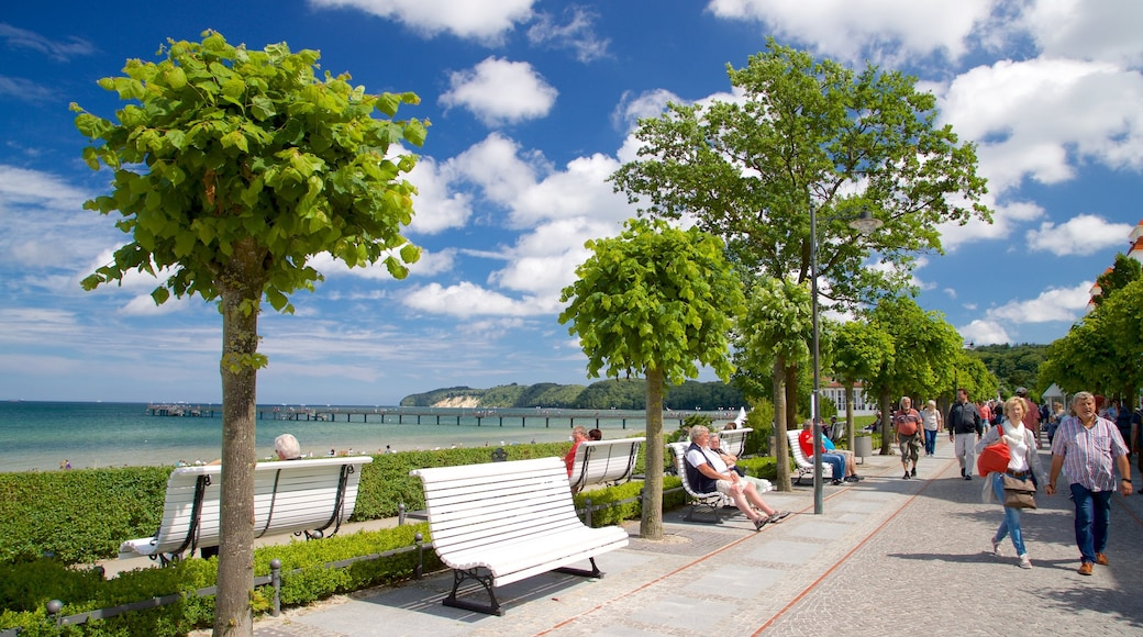 Ostseebad Binz which includes street scenes and general coastal views as well as a small group of people