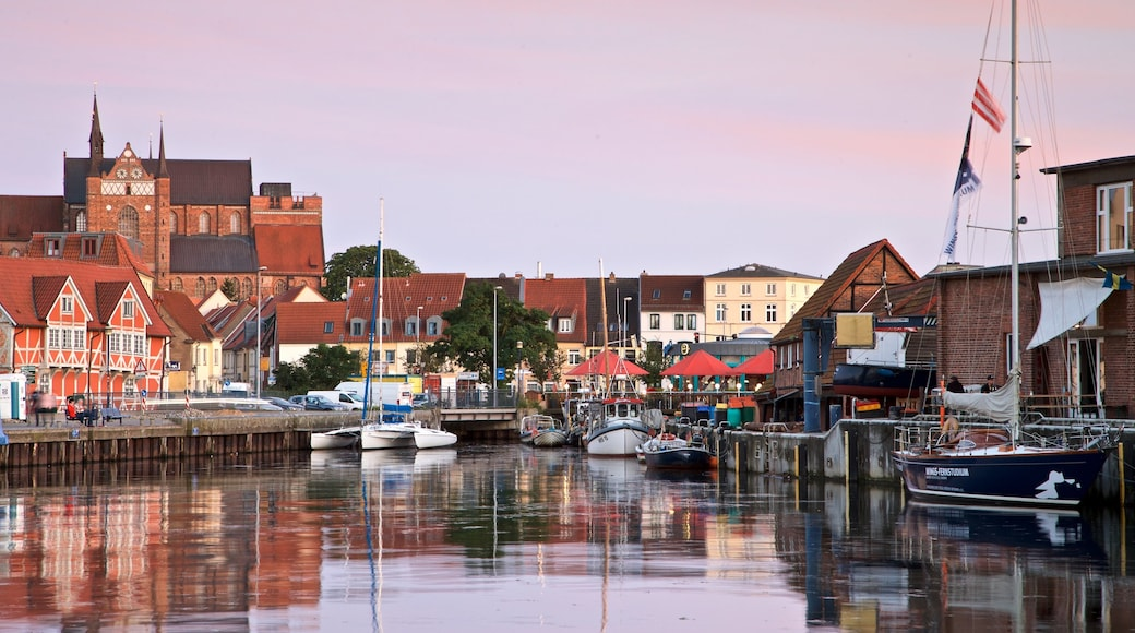 Wismar featuring a sunset and a bay or harbour