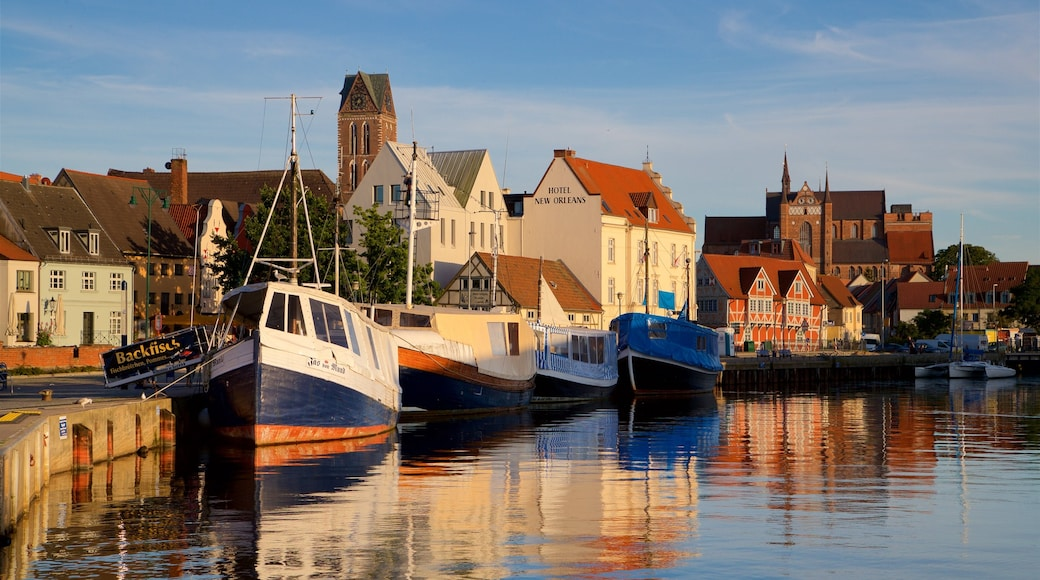 Wismar showing a sunset and a bay or harbour