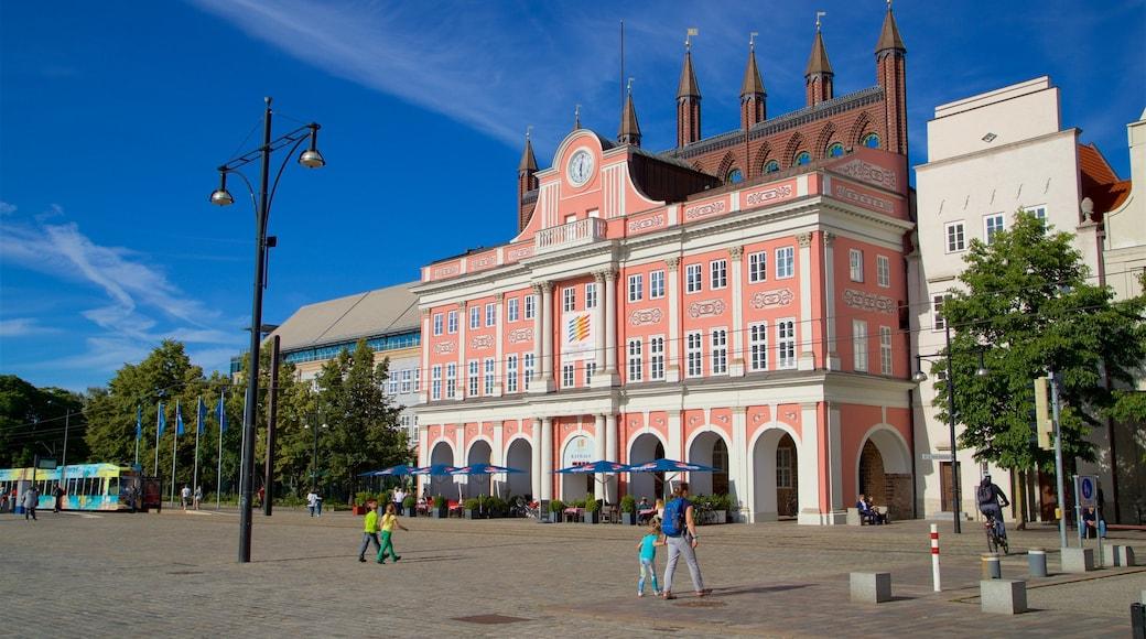 Hôtel de ville montrant square ou place, scènes de rue et patrimoine architectural