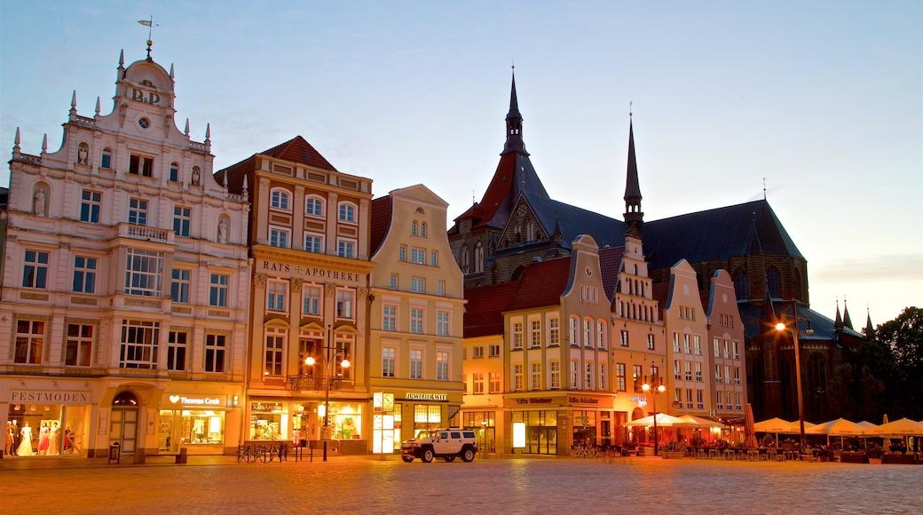 New Market montrant scènes de nuit, ville et square ou place