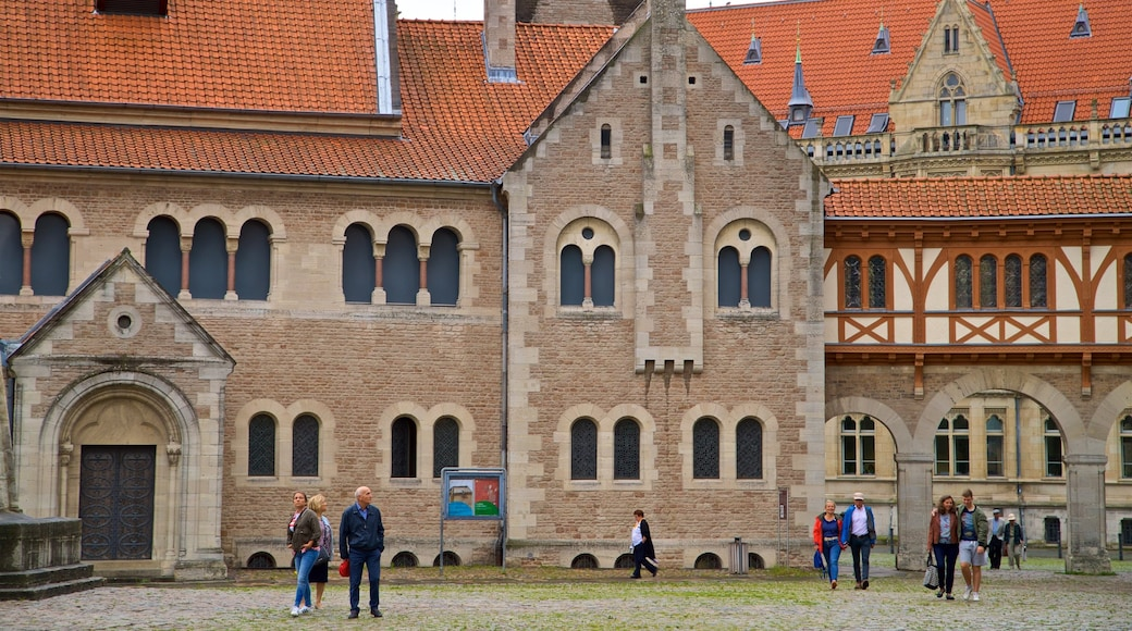 Dankwarderode Castle which includes a church or cathedral, heritage architecture and street scenes