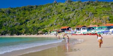 Conchas Beach showing a sandy beach, a coastal town and general coastal views