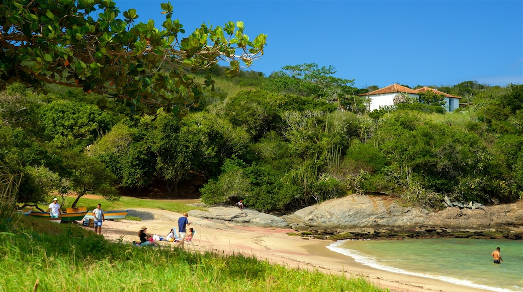 Forno Beach which includes a beach and general coastal views as well as a small group of people