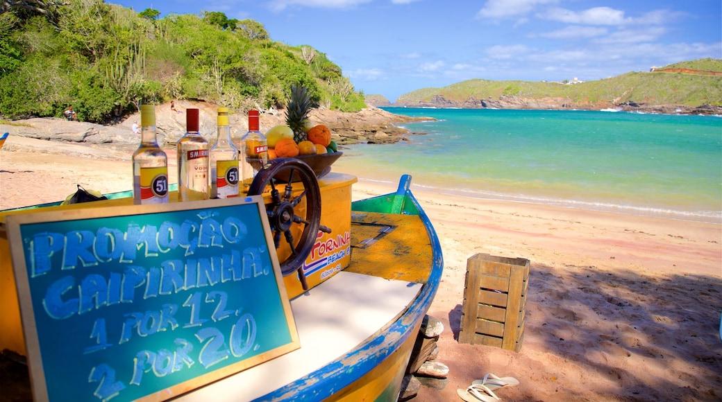 Forno Beach showing a beach bar, a beach and signage