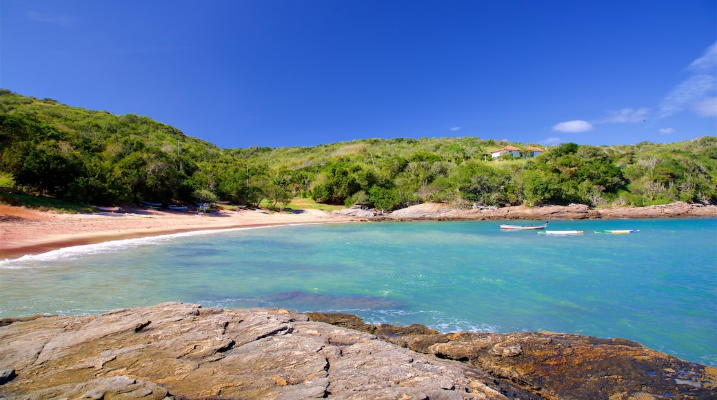 Forno Beach which includes general coastal views, rugged coastline and a beach