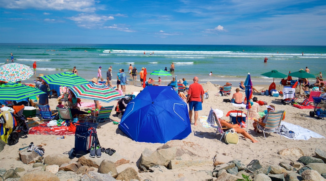 Ogunquit Beach featuring a pebble beach and general coastal views as well as a large group of people