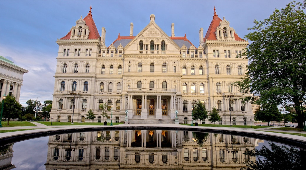 New York State Capitol Building which includes a pond and heritage architecture