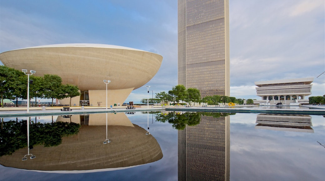 Governor Nelson A. Rockefeller Empire State Plaza featuring modern architecture, a pond and a high rise building