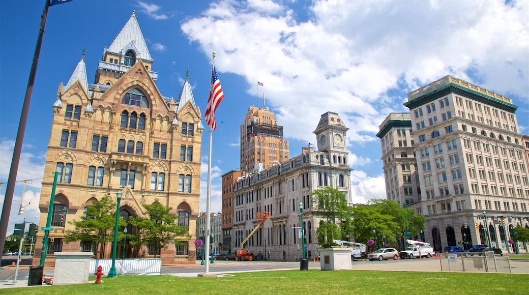 Clinton Square which includes a city, a garden and heritage architecture