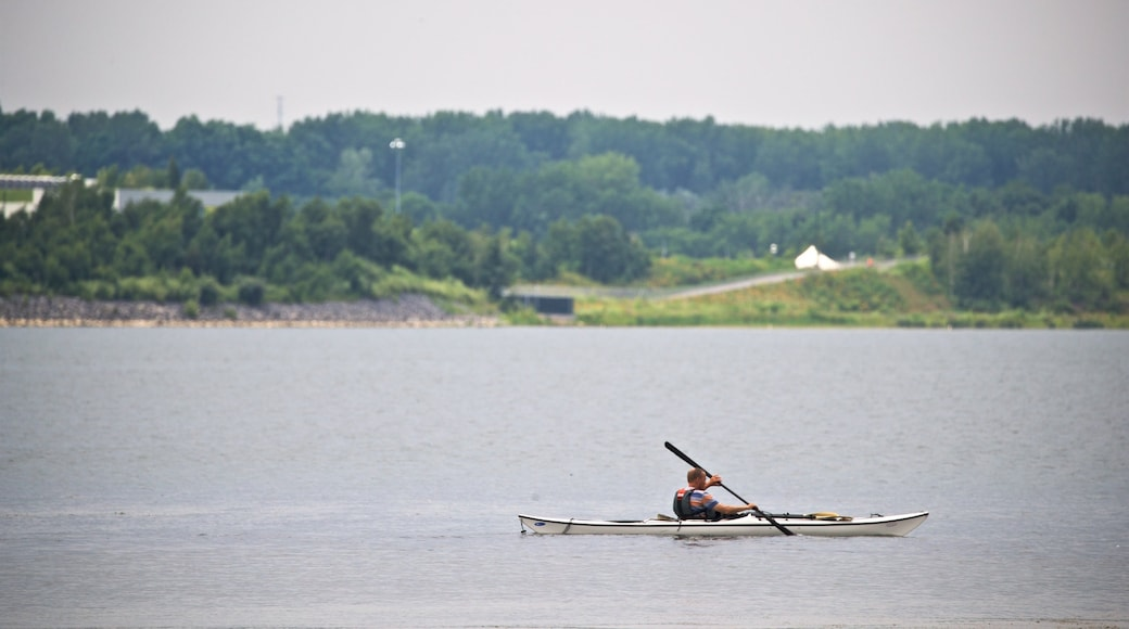 Onondaga Lake Park showing kayaking or canoeing and a lake or waterhole as well as an individual male