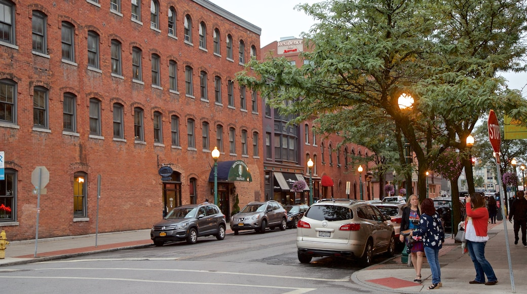 Armory Square featuring street scenes and a city as well as a small group of people