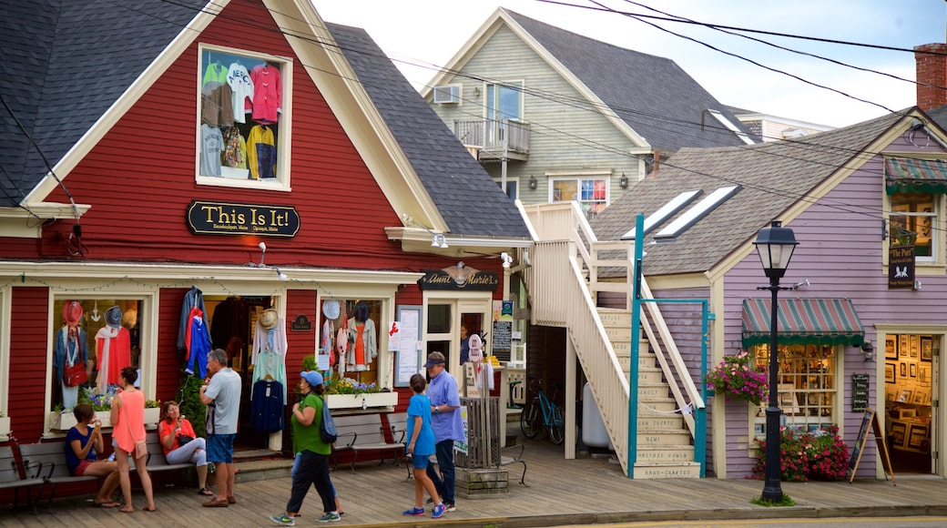 Kennebunkport featuring a small town or village and street scenes as well as a small group of people