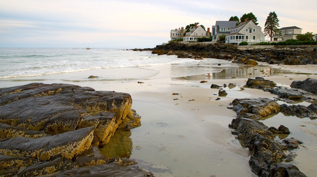 Mother\'s Beach showing rocky coastline, general coastal views and a house
