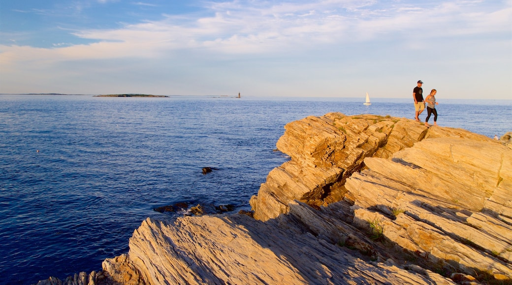 Fort Williams Park which includes a sunset, general coastal views and rocky coastline