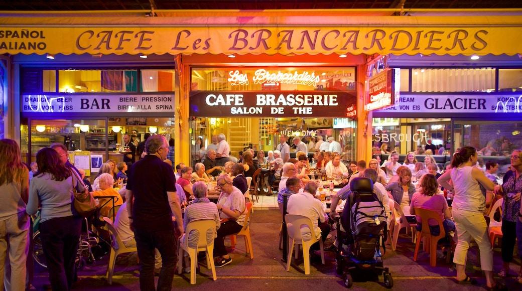 Lourdes - Tarbes montrant scènes de nuit, signalisation et sortie au restaurant