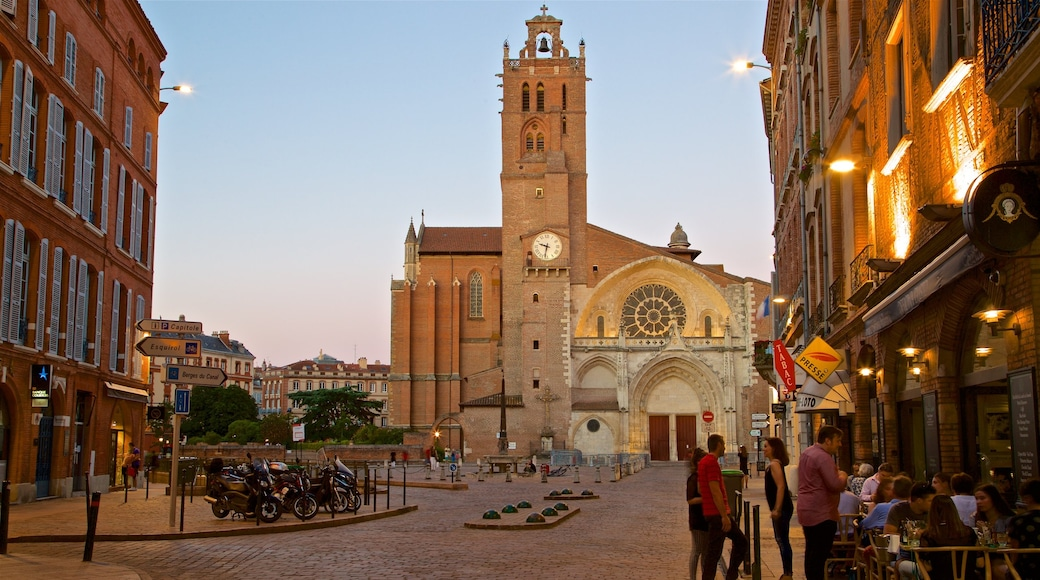 Saint Etienne Cathedrale which includes street scenes, a city and a sunset
