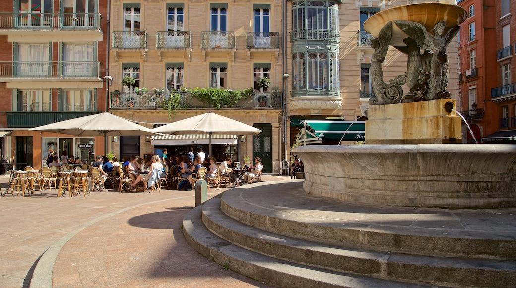 Place Esquirol montrant fontaine et sortie au restaurant aussi bien que petit groupe de personnes