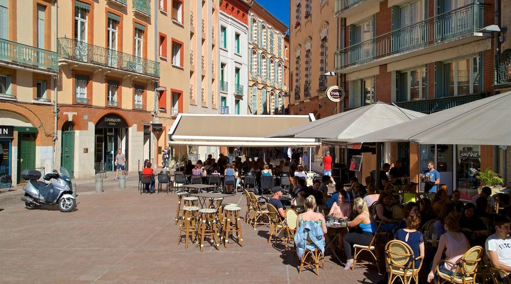 Place Esquirol montrant ville et sortie au restaurant aussi bien que petit groupe de personnes