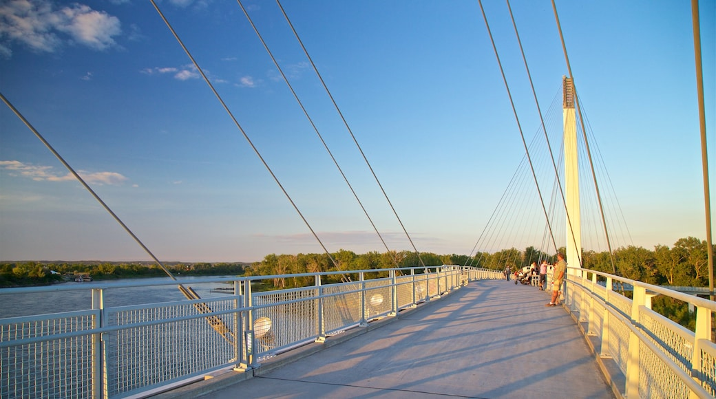 Bob Kerrey Pedestrian Bridge which includes a bridge and a sunset