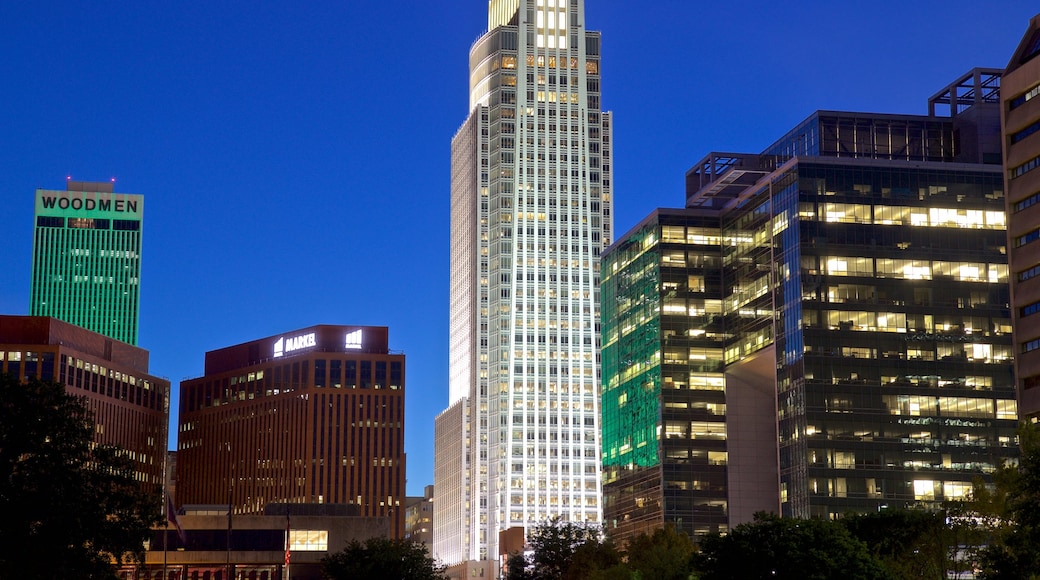 Omaha which includes a skyscraper, night scenes and a city